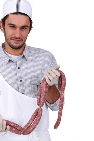 prime adult: Butcher with sausages Stock Photo