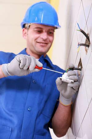 wall socket: Electrician wiring a continental wall socket