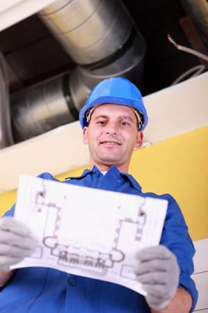 Engineer with a heating plan photo