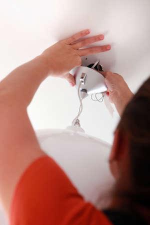 Installing a light fixture photo