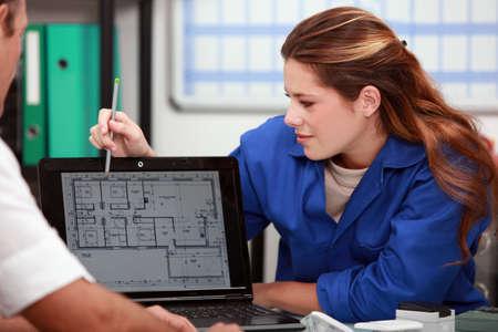 female plumber with customer photo