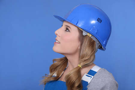 hard look: Portrait of a girl with helmet and overall