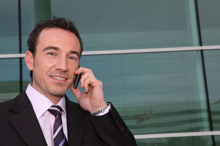Confident businessman on phone Stock Photo - 11824784