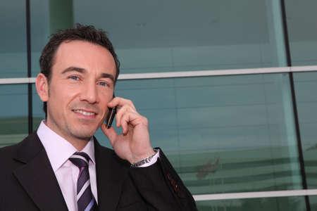 Confident businessman on phone photo
