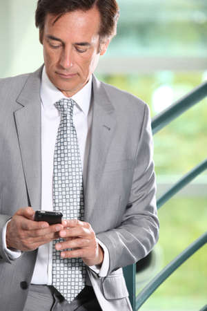 Businessman texting Stock Photo - 11824310