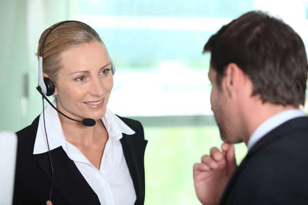 clerical: Secretary giving information to boss
