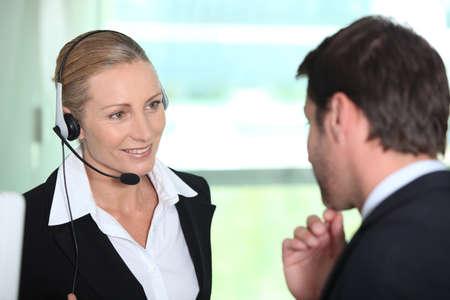 Secretary giving information to boss photo
