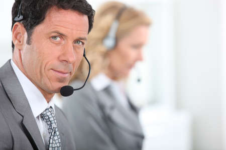 Businessman wearing a telephone headset photo