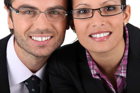 Smiling man woman wearing pairs of eyeglasses photo