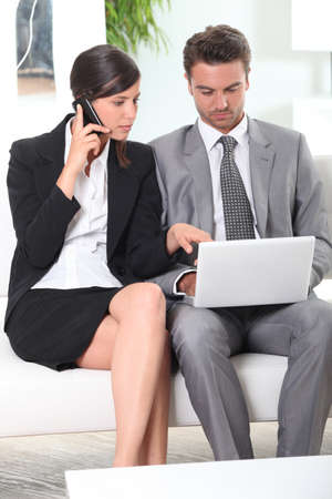 Couple with phone and laptop Stock Photo - 11834019