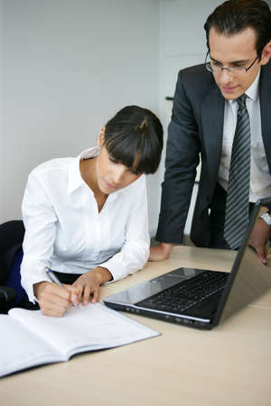 Businessman discussing something with his secretary Stock Photo - 11823165