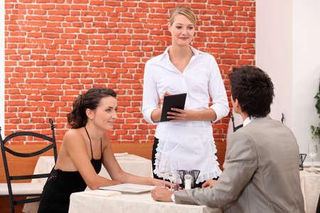 alcohol server: romantic couple in restaurant Stock Photo