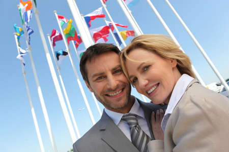 Businessman and woman with flags. Stock Photo - 11825502