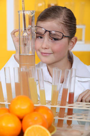 haematologists: Little girl conducting experiment on oranges