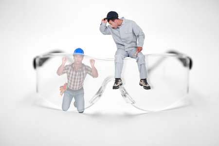 photomontage: Photomontage of workers with giant goggles Stock Photo