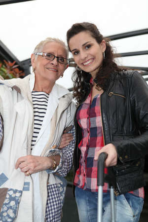 carer: Grandmother and granddaughter smiling