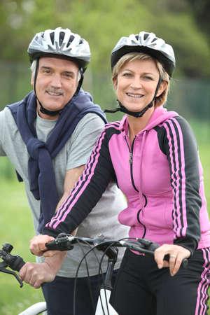 activity holiday: Senior couple having a bike ride