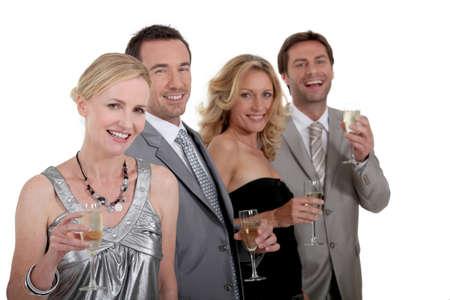 Two couples celebrating Stock Photo - 11824671