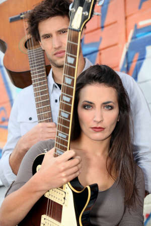 young woman and man playing in a music band photo
