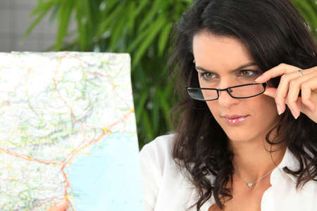 Brunette looking at map photo
