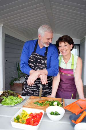 Couple preparing vegetables photo