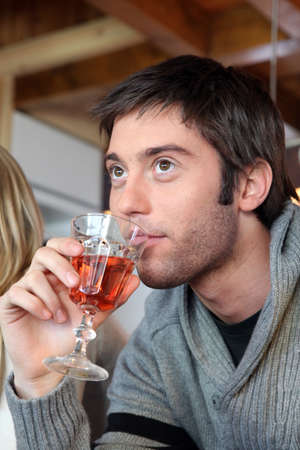 Young man with a glass of rose wine photo