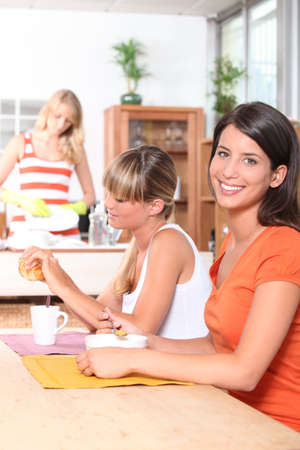 dormitory: Young women having breakfast together