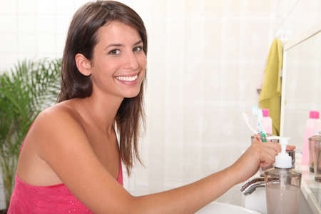 Young woman brushing her teeth Stock Photo - 11825516