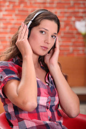 A woman listening to music photo