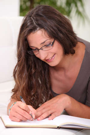 Woman writing in her diary Stock Photo - 11824903