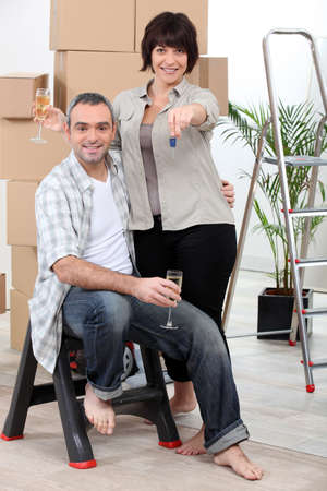Couple celebrating moving into their new home photo
