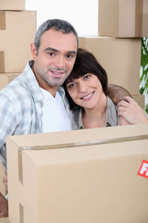 put away: a couple in front of a pile of cartons