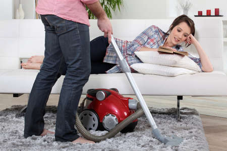 Man using vacuum cleaner photo