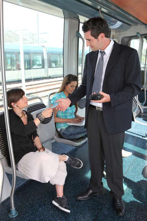 collectors: ticket collector in tramway Stock Photo