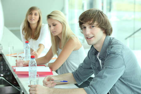 coursework: Young people in a bar with coursework and bottles of water Stock Photo