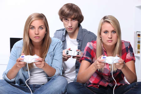 free time: teenagers playing video games Stock Photo