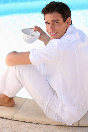 portrait of a man with coffee bowl photo