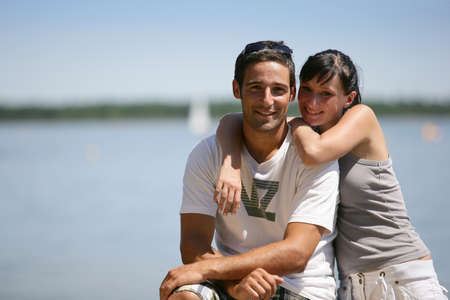 Couple by lake photo