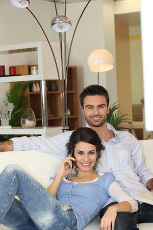 25 35: Couple in living-room Stock Photo