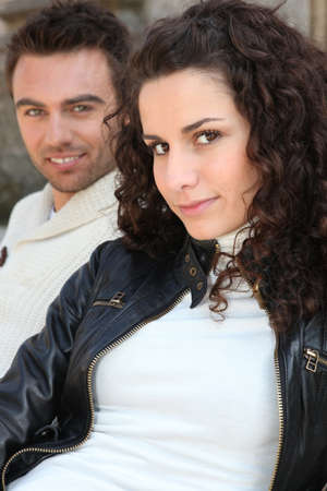 turtleneck: Couple of models posing outdoors Stock Photo