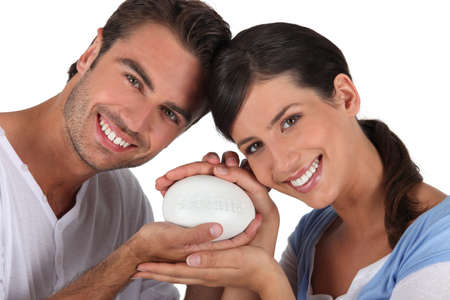 anti bacterial soap: Couple holding bar of soap
