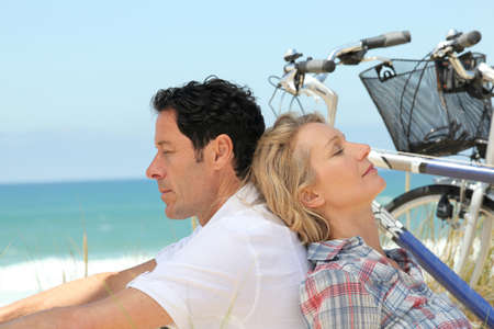 30 34 years: Couple alseep with bikes by the sea