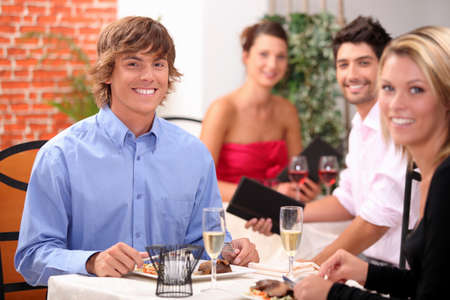 wooing: Young couple having a meal in a restaurant together
