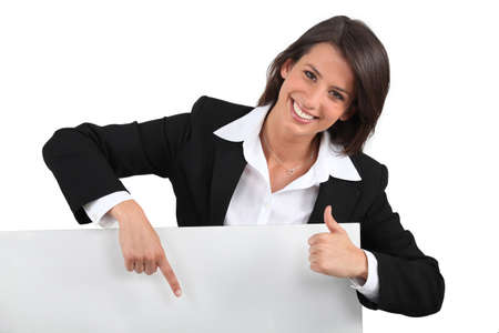 Businesswoman holding blank message board photo