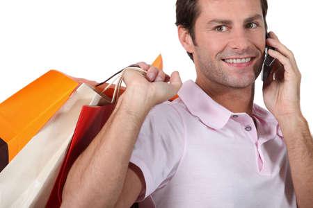Man on phone shopping Stock Photo