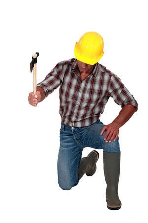 Construction worker using an axe photo