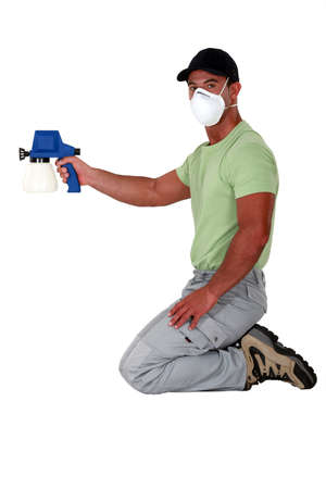Man holding paint sprayer photo
