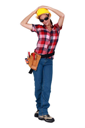 female construction worker: A female construction worker with sunglasses on.