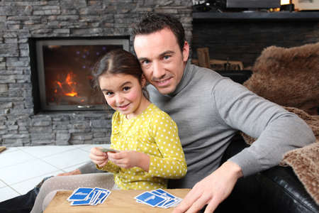 snuggle: Young girl playing a game with her father