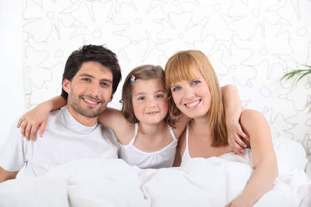 baby underwear: parents in bed with child